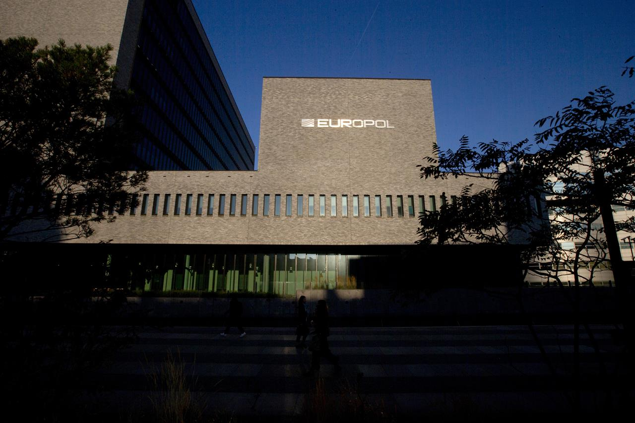 FILE - In this file photo dated Wednesday, Oct. 10, 2018, the Europol headquarters building in The Hague, Netherlands. European Europol and North American cyber cops have joined forces Wednesday Jan. 27, 2021, to disrupt what may be the world's largest network for seeding malware infections, striking a major blow against criminal gangs that have been using it for years to install ransomware in extortion schemes, steal data and engage in financial theft.(AP Photo/Peter Dejong, FILE)