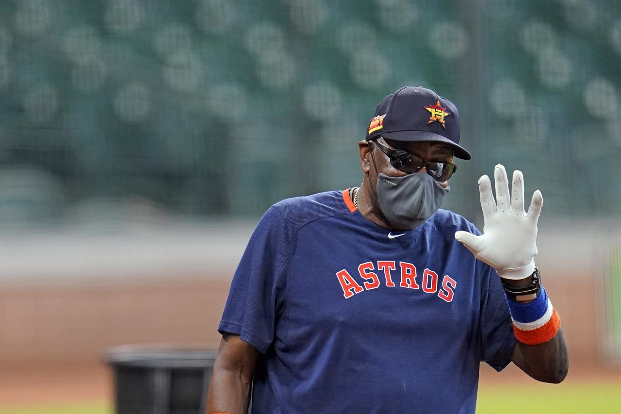 FILE - Houston Astros manager Dusty Baker gestures during a baseball practice at Minute Maid Park in Houston, in this Saturday, July 4, 2020, file photo. Astros manager Dusty Baker said he had been vaccinated against COVID-19 as the team began spring training Thursday, Feb. 18, 2021. (AP Photo/David J. Phillip, File)