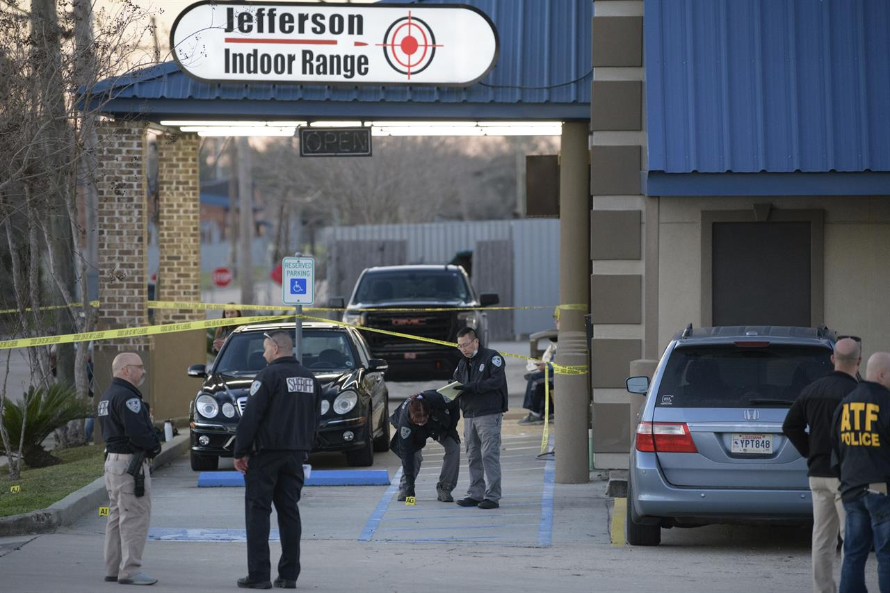 Jefferson Parish Sheriff's Office and Bureau of Alcohol, Tobacco, Firearms and Explosives: ATF investigators look at evidence at the scene of a multiple fatality shooting at the Jefferson Gun Outlet in Metairie, La. Saturday, Feb. 20, 2021. A person went into a gun store and shooting range in a New Orleans suburb and fatally shot two people Saturday, causing customers and staff to open fire on the shooter, said a sheriff. The shooter also died..(AP Photo/Matthew Hinton)