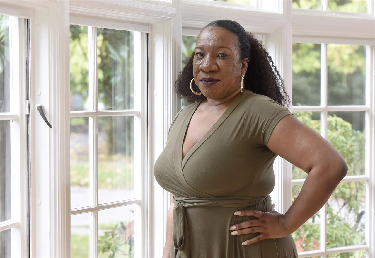 Tarana Burke, founder and leader of the #MeToo movement, stands in her home in Baltimore on Oct. 13, 2020. A coalition of three groups vital to the #MeToo movement is collaborating on an initiative to focus on a population that has often felt left out of the conversation: Black survivors of sexual violence. It's been more than three years since the #MeToo movement exploded into view, but Burke, the activist who gave the movement its name, says concrete change has been incremental at best — even more so for the Black community. (AP Photo/Steve Ruark, file)