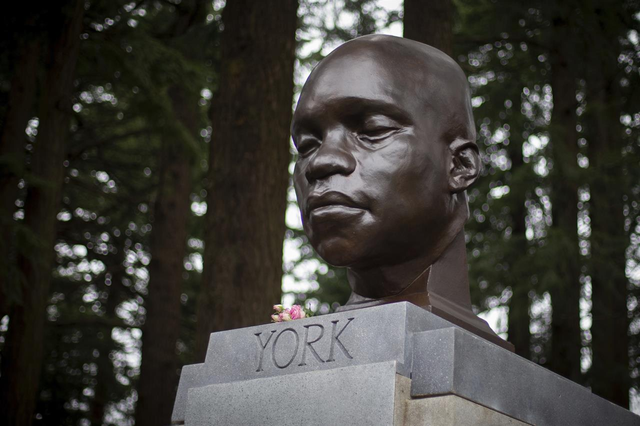 A bust of York, a member of the Lewis and Clark expedition, is seen on Mount Tabor in southeast Portland, Ore., on Sunday Feb. 21, 2021. The statue appeared the day before. (Mark Graves/The Oregonian via AP)