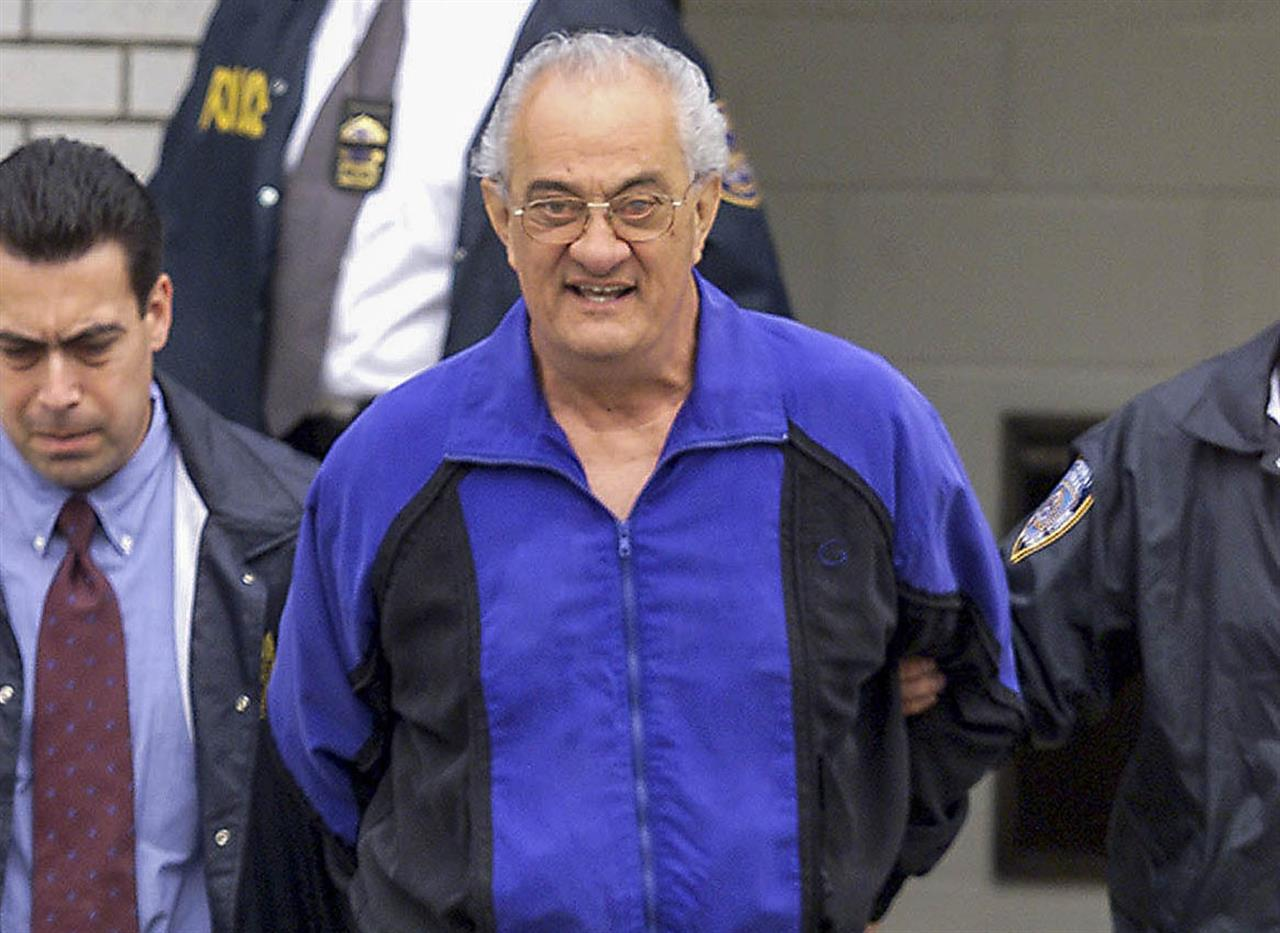 FILE - In this June 4, 2002, file photo, Peter Gotti, center, is escorted out of the Waterfront Commission following his arrest in the Brooklyn borough of New York. Gotti, the brother of notorious Gambino crime boss John Gotti, has died while serving a federal prison sentence, a person familiar with the matter told The Associated Press on Thursday, Feb. 25, 2021. Gotti, 81, died of natural causes while incarcerated at the Federal Medical Center in Butner, N.C., said the person, who could not discuss the matter publicly and spoke to the AP on condition of anonymity. (Mike Albans/The Daily News via AP, File)