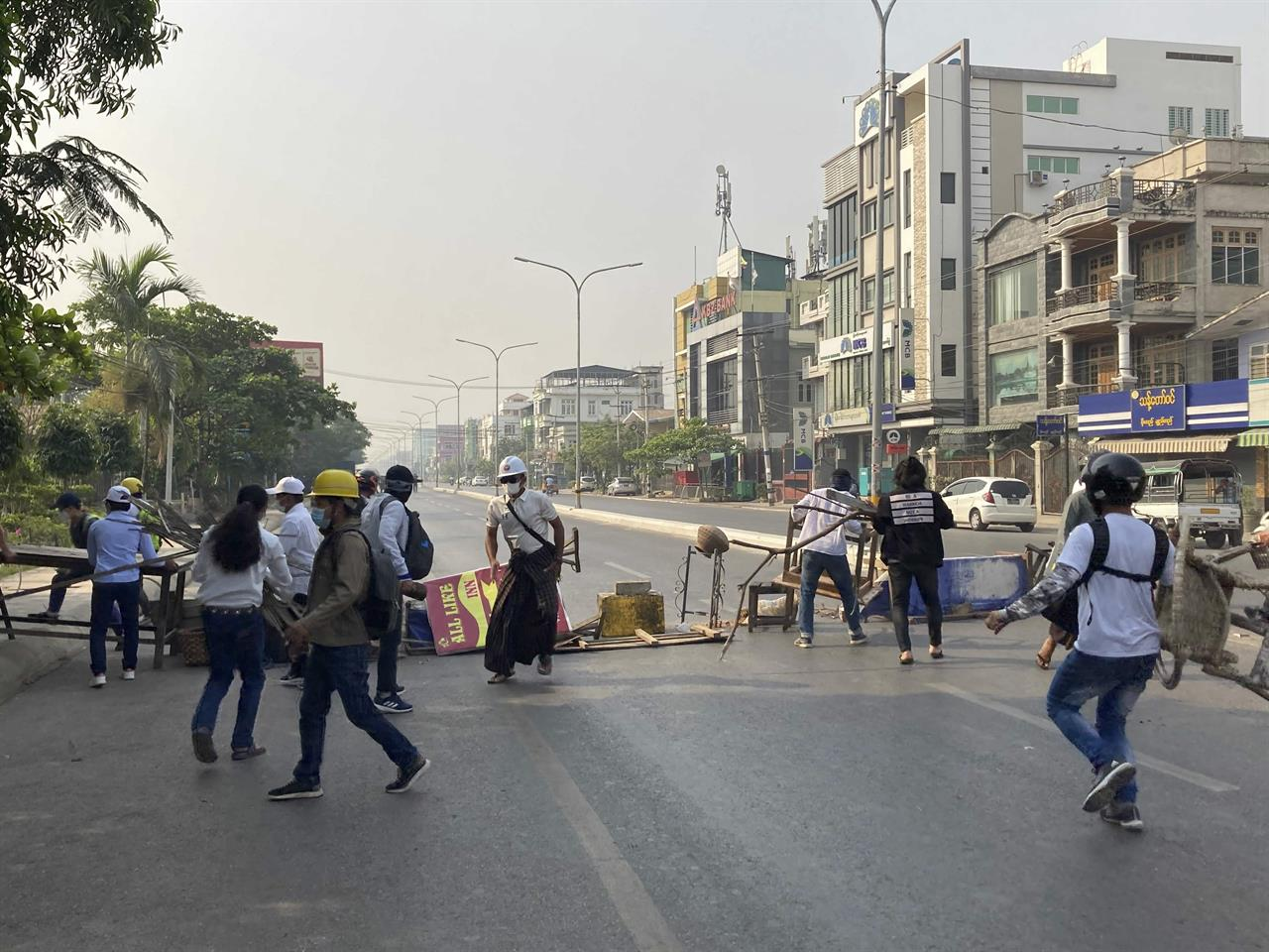 Protesters block a main road during a protest against the military coup in Mandalay, Myanmar, Sunday, Feb. 28, 2021. Police in Myanmar escalated their crackdown on demonstrators against this month's military takeover, deploying early and in force on Saturday as protesters sought to assemble in the country's two biggest cities and elsewhere. (AP Photo)