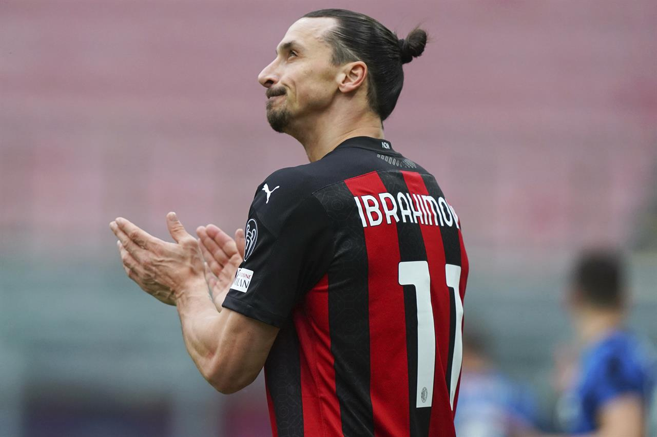 AC Milan's Zlatan Ibrahimovic looks up during the Serie A soccer match between AC Milan and Inter Milan, at the San Siro Stadium in Milan, Italy, Sunday, Feb. 21, 2021. (Spada/LaPresse via AP)