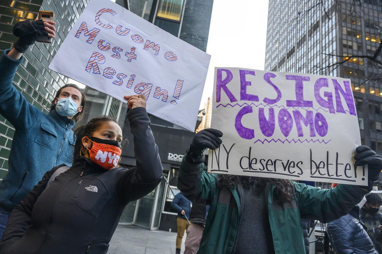 People rally for New York Gov. Andrew Cuomo's resignation in front of his Manhattan office in New York, Tuesday, March 2, 2021. Cuomo is facing calls for resignations from some members of his own party as most leading Democrats signal they want to await the results of the attorney general's investigation into claims the governor sexually harassed aides. (AP Photo/Brittainy Newman)