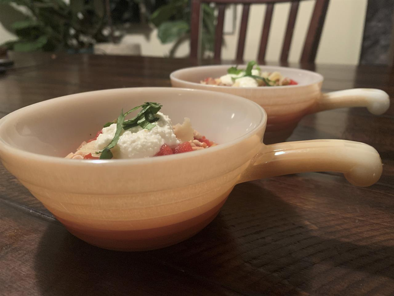 This image provided by Tracee Herbaugh depicts two vintage peach lustre Fire King chili bowls. There are lustrous chili bowls with handles, stackable refrigerator boxes, and casserole dishes set on top of brass candle warmers. These are durable dishes, often smaller than modern serving pieces, that can go from freezer to oven to table. But collectors usually acquire them for enjoyment, not utility. (Tracee Herbaugh via AP)