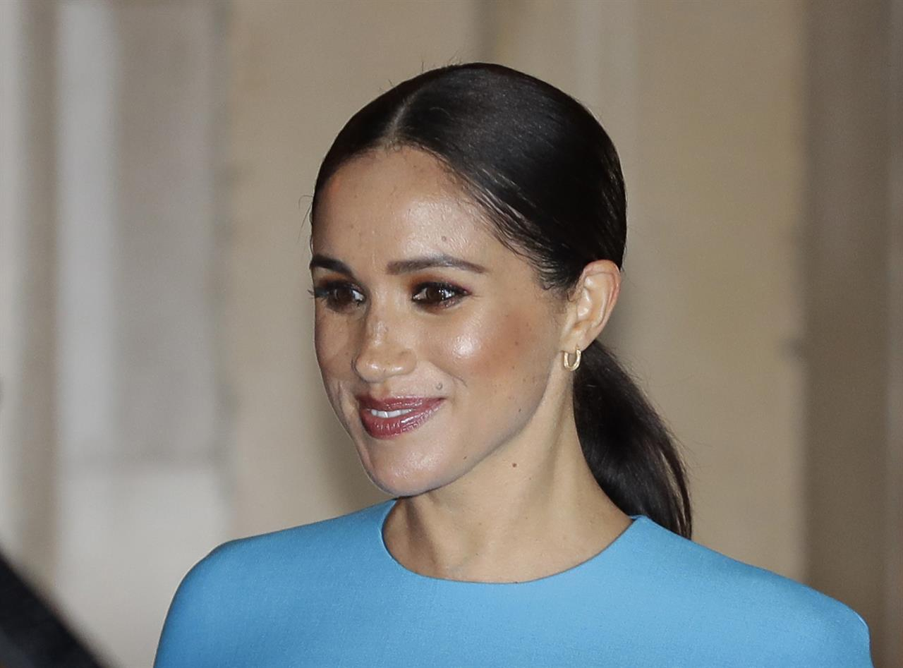 FILE - In this file photo dated Thursday, March 5, 2020,  Britain's Meghan, the Duchess of Sussex leaves after attending the annual Endeavour Fund Awards in London.  A British newspaper publisher on Tuesday March 2, 2021, is seeking permission to appeal against a judge's ruling that it invaded the privacy of the Duchess of Sussex by publishing parts of a letter she wrote to her estranged father after her 2018 marriage to Prince Harry. (AP Photo/Kirsty Wigglesworth, FILE)