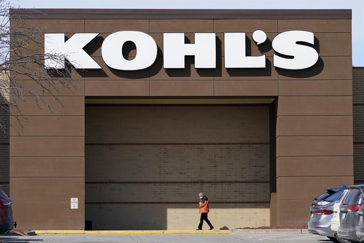 This Thursday, Feb. 25, 2021, photo shows a woman arriving at a Kohl's store in West Des Moines, Iowa. Kohl's reported mixed results for its fiscal fourth quarter, delivering a 30% increase in profits but a 10% drop in sales.  Results announced Tuesday, March 2, handily beat Wall Street estimates. (AP Photo/Charlie Neibergall)