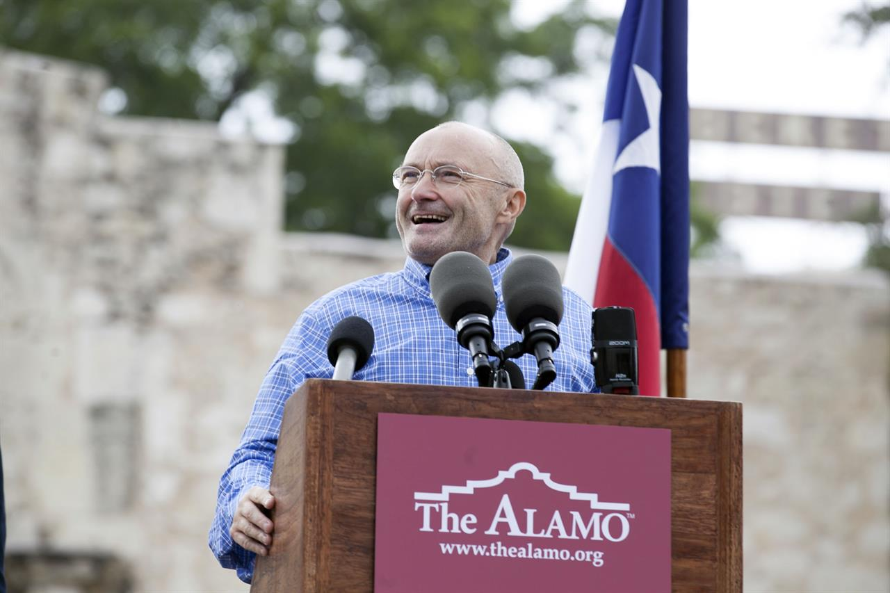 FILE - Singer Phil Collins appears in front of the Alamo to announce his donation of over 200 Texas Revolution-era artifacts to the Texas General Land Office on June 26, 2014. A temporary exhibit, which includes a brass cannon used by the Mexican Army during the Battle of the Alamo and the original battle orders that calling for the attack on the Alamo, is on display beginning Tuesday, March 2, 2021 through April 25. (Julysa Sosa/The San Antonio Express-News via AP, File)