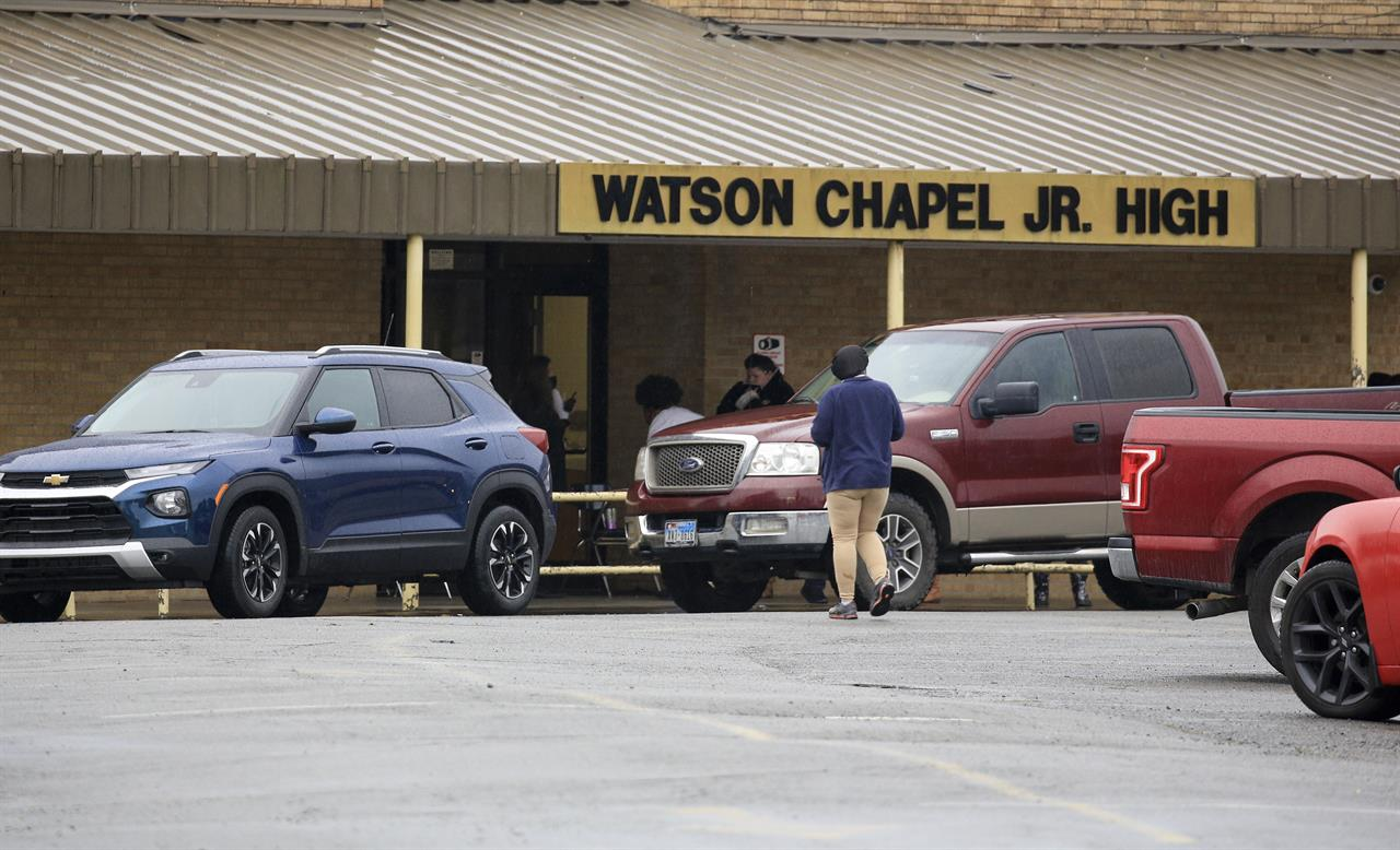 Traffic is lined up Monday March 1, 2021 outside Watson Chapel Junior High School in Pine Bluff, Ark. as parents pick up students after a shooting at the school. (Staton Breidenthal/The Arkansas Democrat-Gazette via AP)