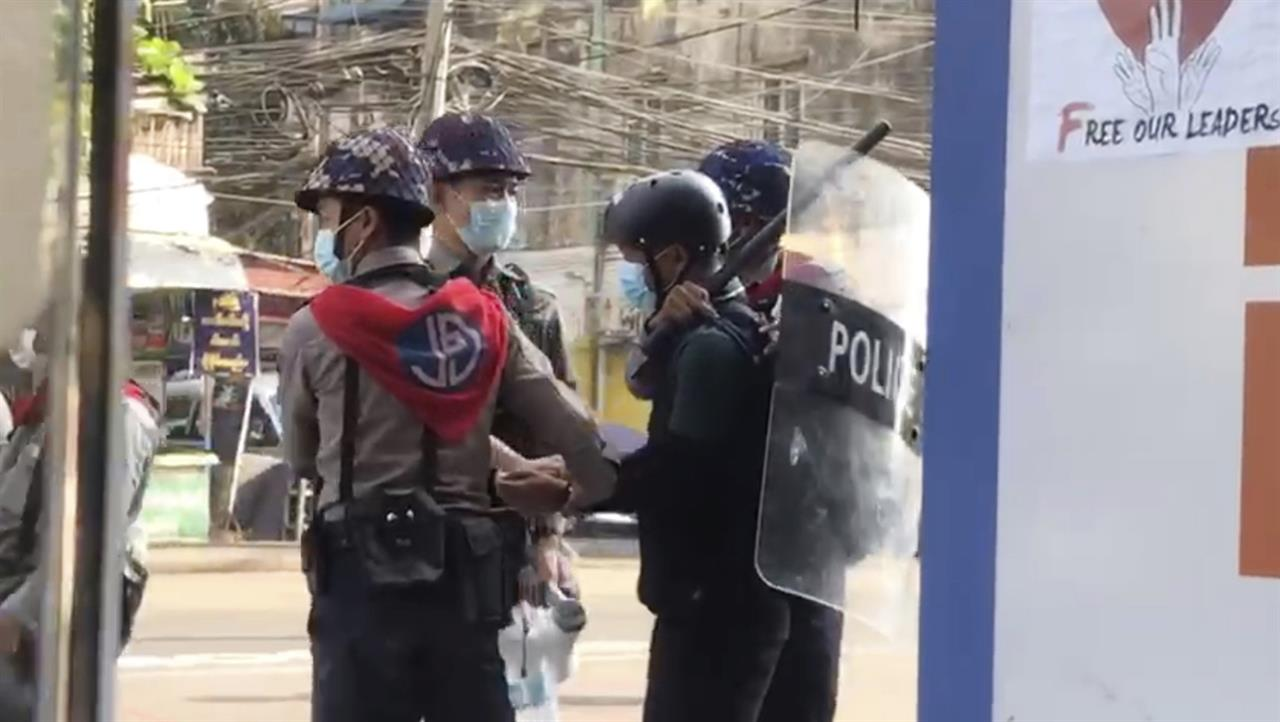 In this image made from video taken on Feb. 27, 2021, Associated Press journalist Thein Zaw is arrested by police in Yangon, Myanmar. Authorities in Myanmar have charged Thein Zaw and five other members of the media with violating a public order law that could see them imprisoned for up to three years. The six were arrested while covering protests against the Feb. 1 military coup in Myanmar that ousted the elected government of Aung San Suu Kyi. (AP Photo)