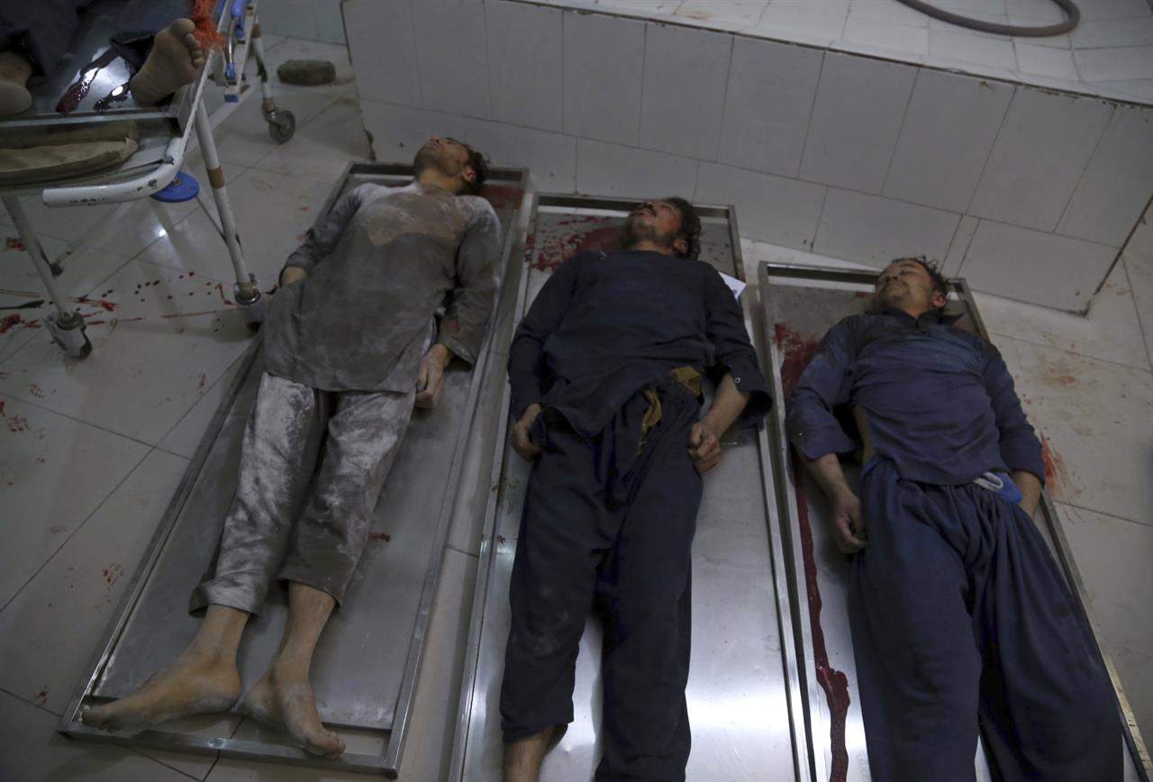 EDS NOTE: GRAPHIC CONTENT - The bodies of Afghan civilians, who were killed by unknown gunmen at a plaster factory overnight, lie in a hospital morgue in Jalalabad, Nangarhar, east of Kabul, Afghanistan, Thursday, March 4, 2021. The victims were Hazaras, members of Afghanistan's minority Shiite community. (AP Photo)