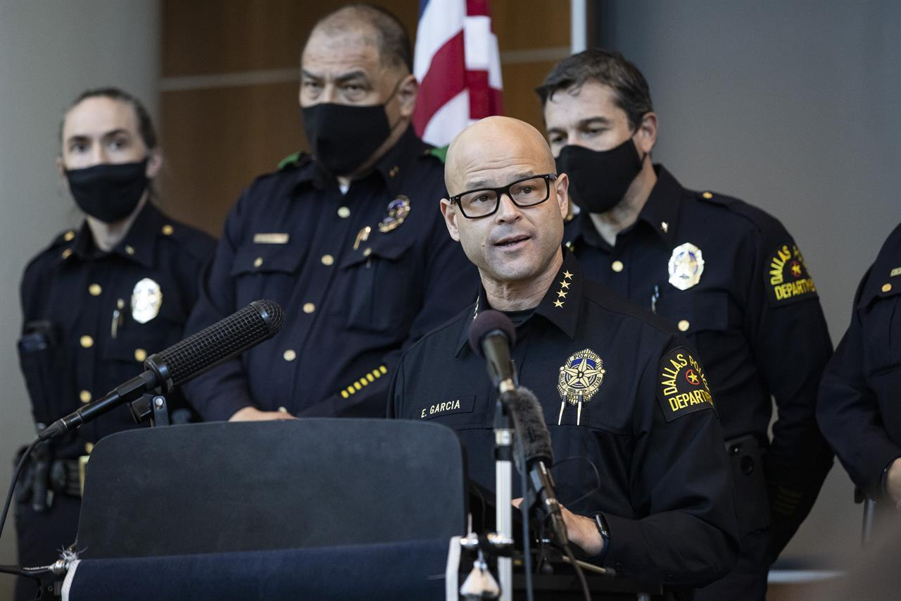 Chief Eddie García, center, speaks with media during a press conference regarding the arrest and capital murder charges against Officer Bryan Riser at the Dallas Police Department headquarters on Thursday, March 4, 2021, in Dallas. Riser was arrested Thursday on two counts of capital murder in two unconnected 2017 killings that weren't related to his police work, authorities said. Riser, a 13-year veteran of the force, was taken into custody Thursday morning and brought to the Dallas County Jail for processing, according to a statement from the police department. (Lynda M. González/The Dallas Morning News via AP)