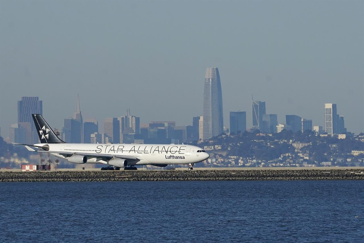 FILE - In this Tuesday, Dec. 22, 2020 file photo, A Lufthansa Star Alliance plane prepares to take off at San Francisco International Airport during the coronavirus pandemic in San Francisco. he hack of a company that manages ticket-processing and frequent-flier data for major global airlines — including Star Alliance and OneWorld members — has compromised the personal data of an unspecified number of travelers. The hackers were able to access some computer systems at Atlanta-based SITA Passenger Service System for up to a month before the incident's seriousness was confirmed on Feb. 24, 2021 a spokesman for the company's Geneva-based parent company said.(AP Photo/Jeff Chiu, File)