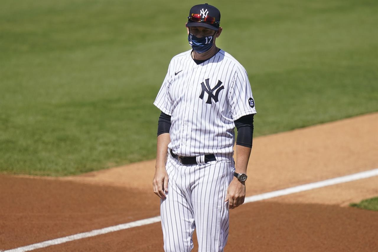 New York Yankees' Manager Aaron Boone stands on the field before a spring baseball game against the Toronto Blue Jays Sunday, Feb. 28, 2021, in Tampa, Fla.  (AP Photo/Frank Franklin II)