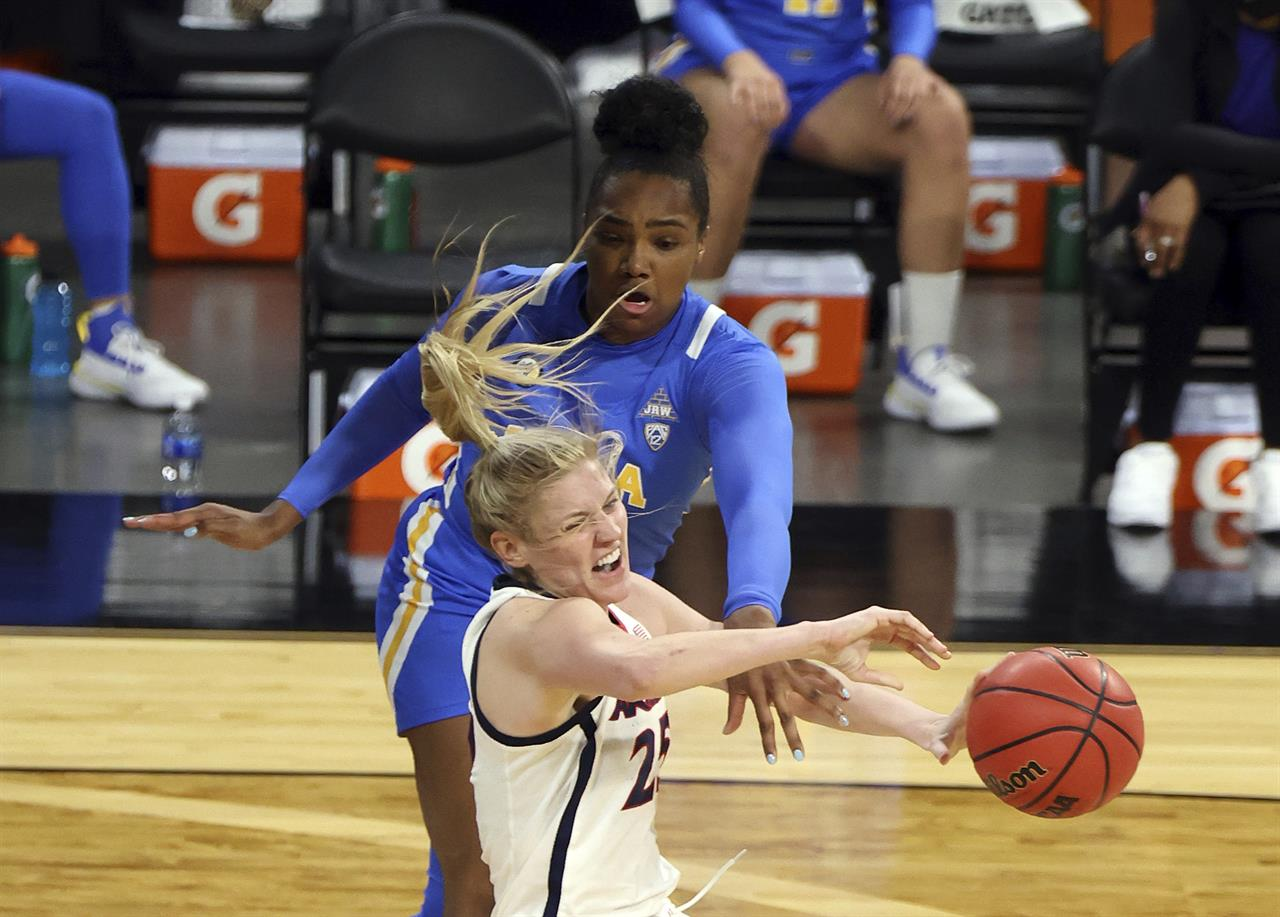 UCLA forward Lauryn Miller (33) and Arizona forward Cate Reese (25) fight for control of the ball during the first half of an NCAA college basketball game in the semifinals of the Pac-12 women's tournament Friday, March 5, 2021, in Las Vegas. (AP Photo/Isaac Brekken)