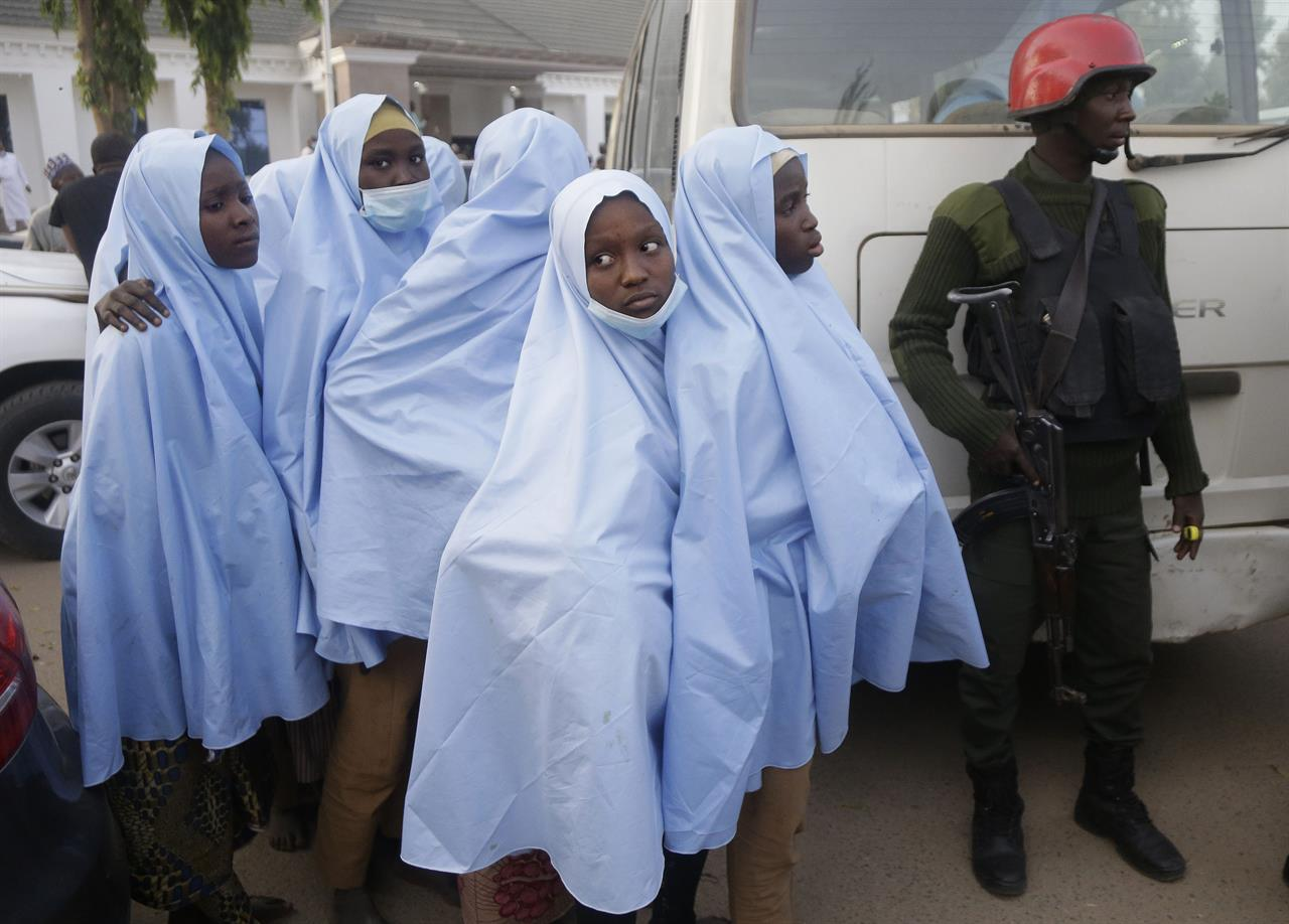 Some of the Government Girls Secondary School students who were abducted by gunmen the previous week in Jangebe, Nigeria, wait for a medical checkup after a meeting with Zamfara state Gov. Bello Matawalle, in Gusau, northern Nigeria, on Tuesday, March 2, 2021. Matawalle announced that 279 girls who were abducted from the boarding school in the northwestern part of the state have been released. (AP Photo/Sunday Alamba)