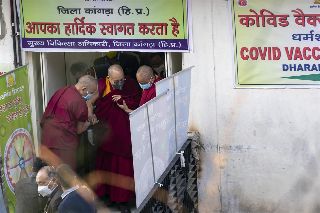 Tibetan spiritual leader the Dalai Lama is helped by two monks as he leaves the Zonal Hospital after receiving a shot of the COVID-19 vaccine in Dharmsala, India, Saturday, March 6, 2021. Medical officers confirmed that the Tibetan leader got the Covishield vaccine and is not showing any adverse reaction to the vaccine. (AP Photo/Ashwini Bhatia)