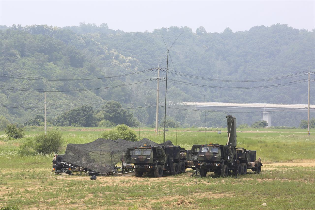 FILE - U.S. Army mobile equipment sits in a field in Yeoncheon, South Korea, near the border with North Korea, Wednesday, June 17, 2020. The State Department says the U.S. and South Korea have reached an agreement in principle on a new arrangement for sharing the cost of the American troop presence. Details were not released, but the State Department's Bureau of Political-Military Affairs said Sunday, March 7, 2021 that the deal includes a negotiated increase in Seoul's share of the cost for the U.S. troop presence. (AP Photo/Ahn Young-joon)