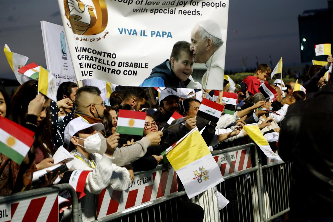 Iraqi Christians say goodbye to Pope Francis after an open air Mass at a stadium in Irbil, Iraq, Sunday, March 7, 2021. Thousands of people filled the sports stadium in the northern city of Irbil for Pope Francis' final event in his visit to Iraq: an open-air Mass featuring a statue of the Virgin Mary that was restored after Islamic militants chopped of the head and hands. (AP Photo/Hadi Mizban)