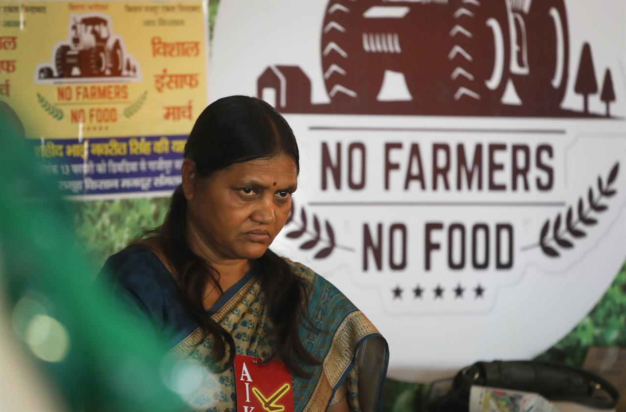 An Indian female farmer activist participates in a protest at the site of ongoing protests by farmers in Ghazipur, Delhi-Uttar Pradesh border, near New Delhi, India, Monday, March 8, 2021. Thousands of female farmers have held sit-ins and a hunger strike in India's capital in protests on International Women's Day against new agricultural laws. (AP Photo/Manish Swarup)
