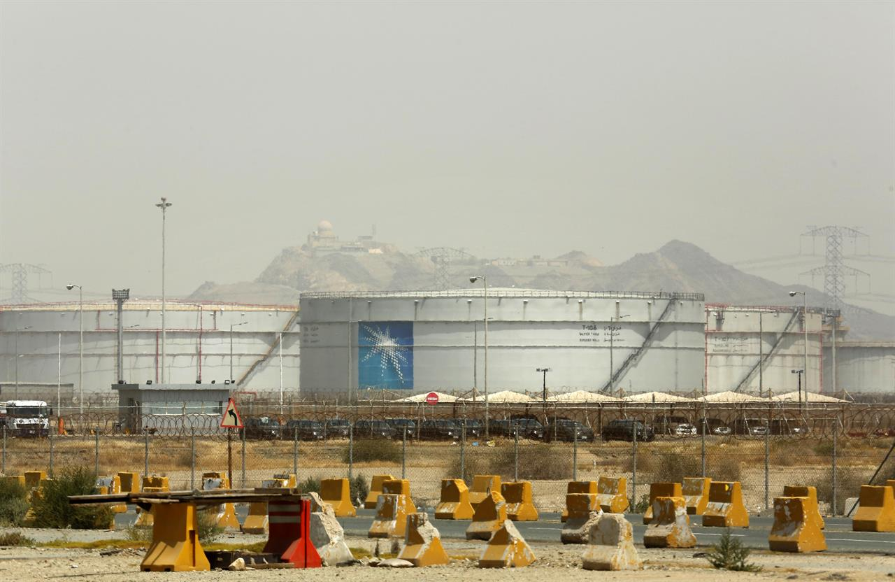 Storage tanks are seen at the North Jiddah bulk plant, an Aramco oil facility, in Jiddah, Saudi Arabia, Sunday, March 21, 2021. Saudi Arabia's state-backed oil giant Aramco announced Sunday that its profits nearly halved in 2020 to $49 billion, a big drop that came as the coronavirus pandemic roiled global energy markets. (AP Photo/Amr Nabil)