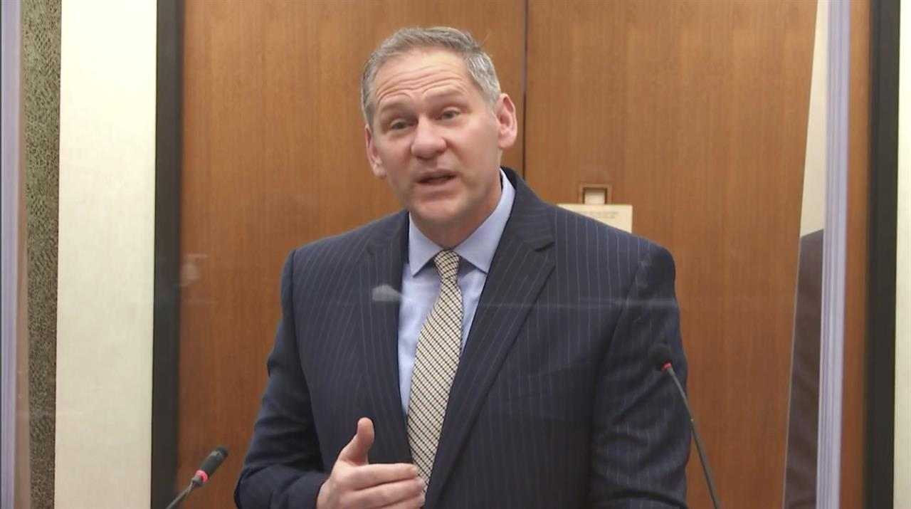 In this image from video, prosecutorSteve Schleicher questions witness Los Angeles police department Sergeant Jody Stiger, as Hennepin County Judge PeterCahill presides Wednesday, April 7, 2021, in the trial of former Minneapolis police Officer Derek Chauvin at the Hennepin County Courthouse in Minneapolis. Chauvin is charged in the May 25, 2020 death of George Floyd. (Court TV via AP, Pool)